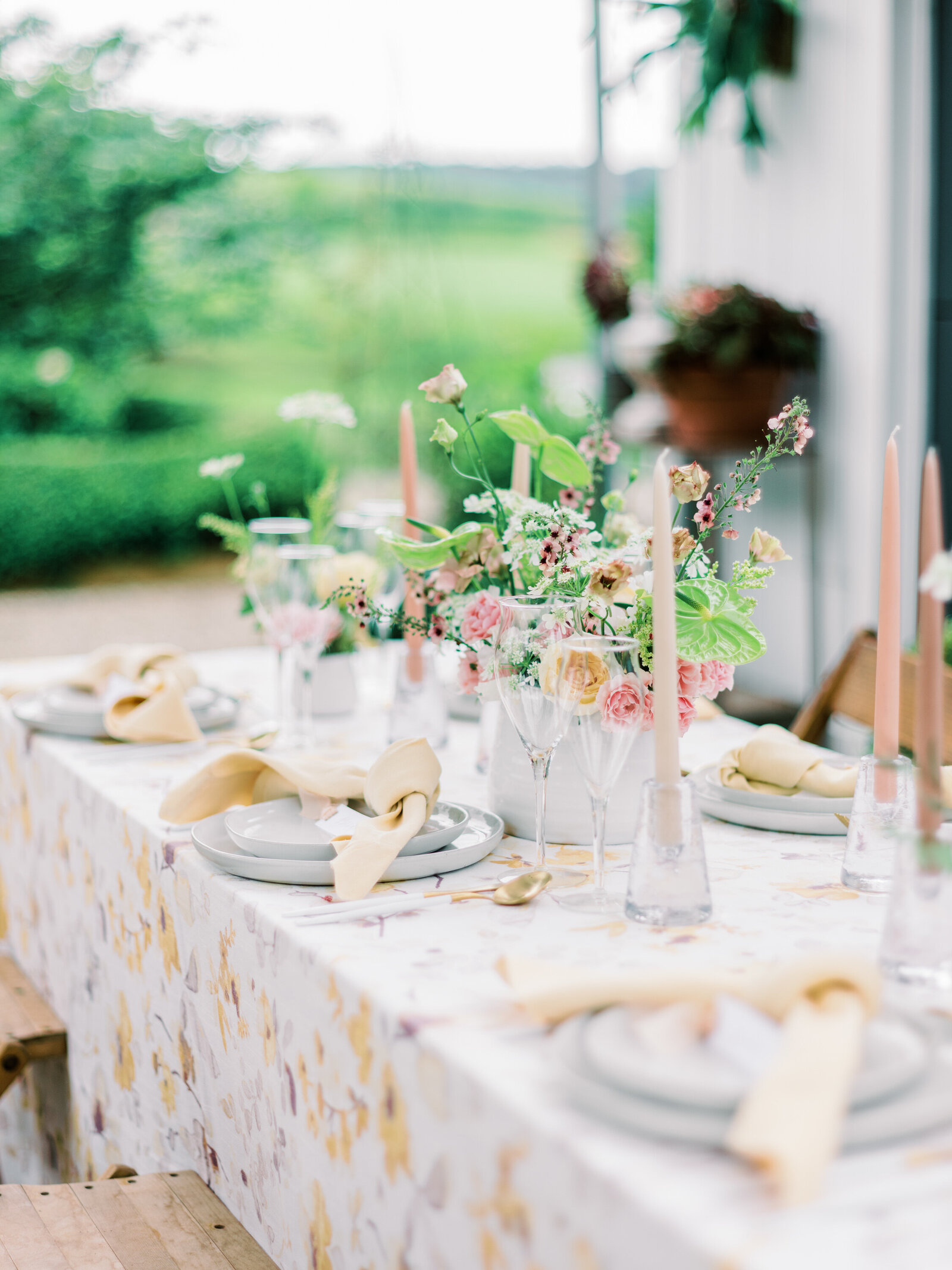 Dinner setting with candles and floral arrangements