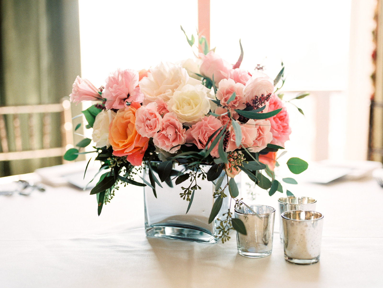 colorful and lush centerpiece from r love floral for luxury wedding reception