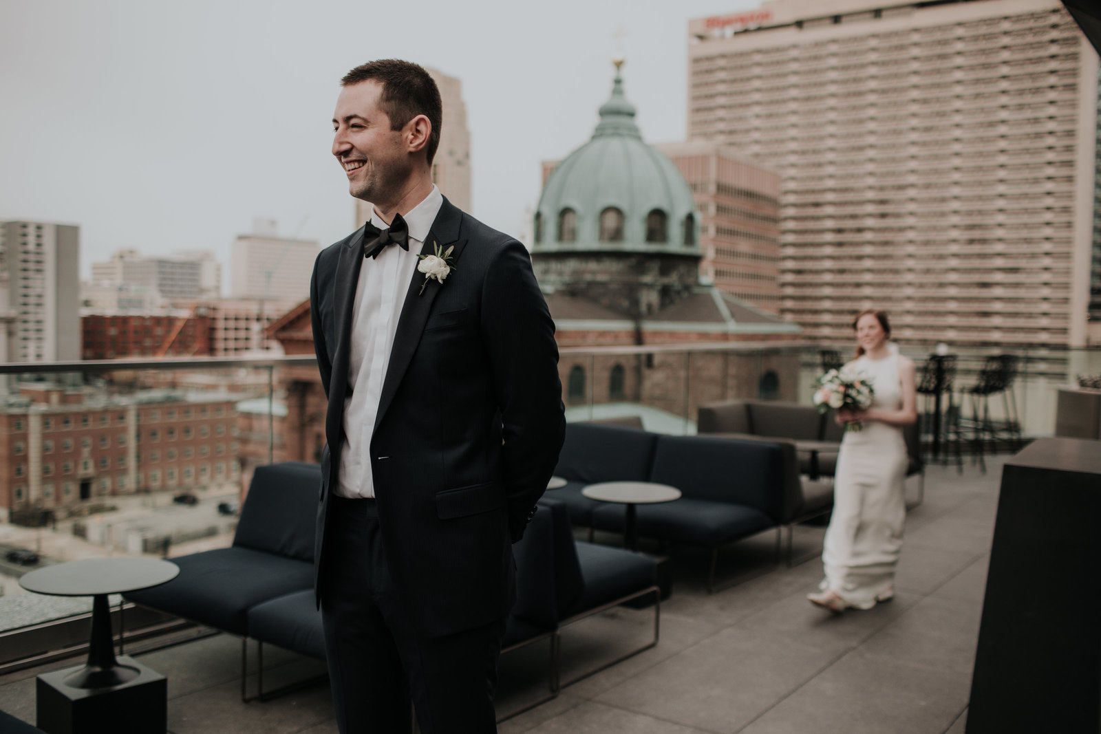 bride and groom have their first look on the rooftop at the logan hotel in philadelphia pa