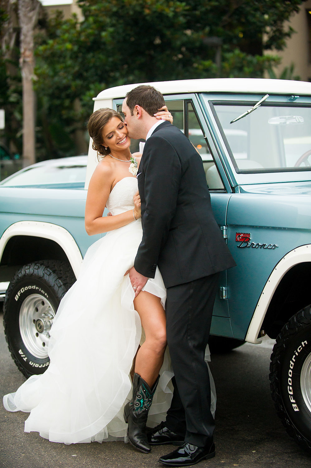 bride and groom with old truck at the dana