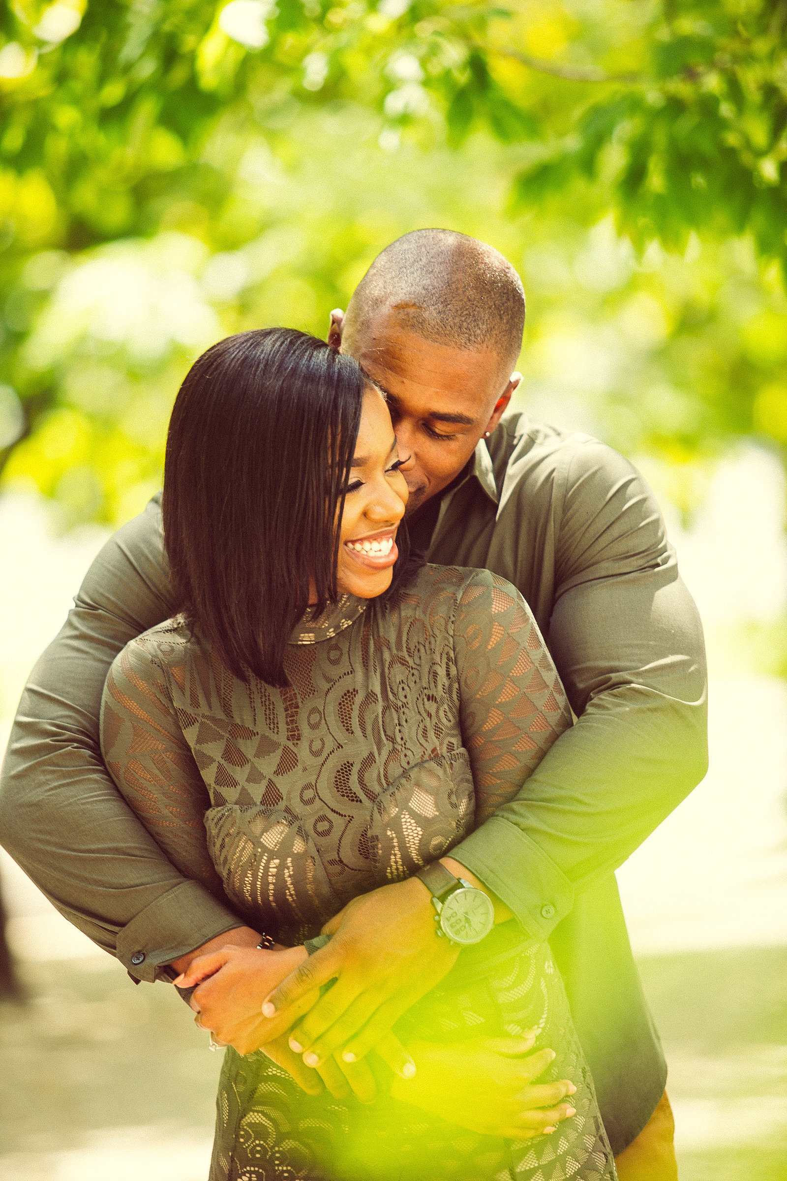 wedding engagement photo black couple hugging St Louis Pinxit Photo