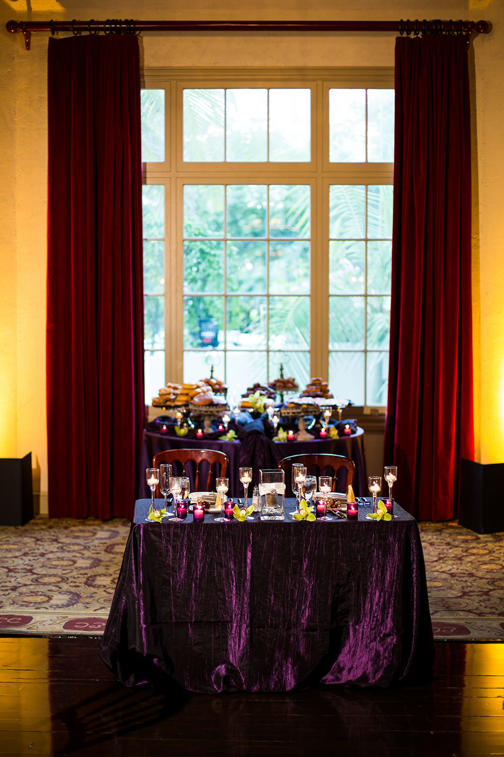 purple tables with lots of candles don room