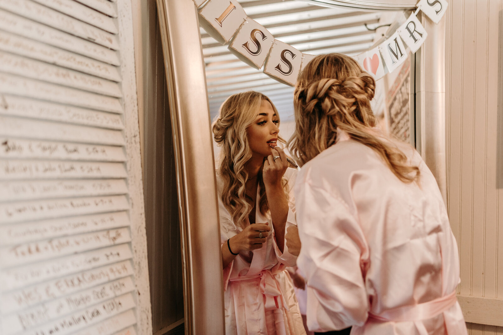 J.Michelle Photography photographs bride getting ready at vintage oaks farm wedding in Athens, Ga