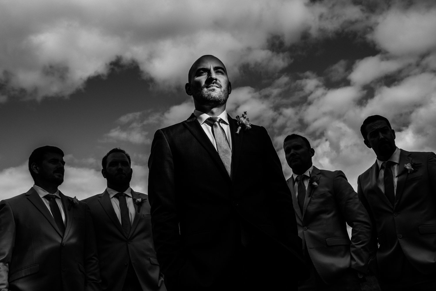 dramatic portrait of a groomsman using a mag mod light