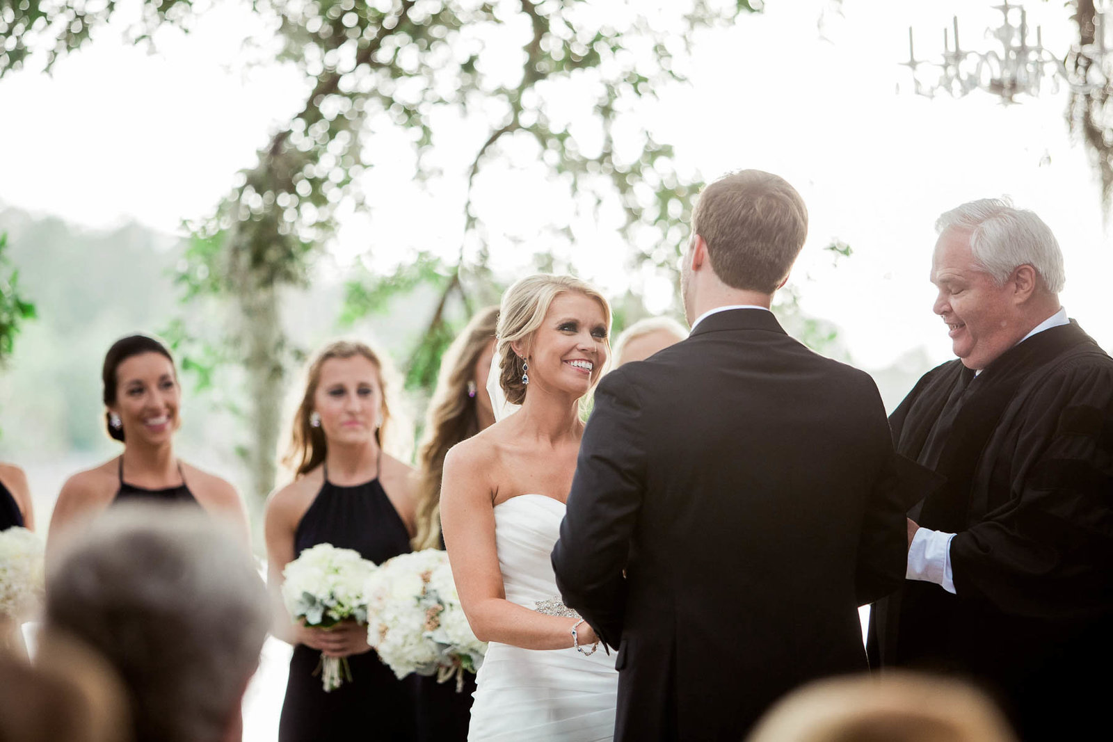 Bride and groom exchange vows under an oak tree, Dunes West Golf and River Club, Mt Pleasant, South Carolina. Kate Timbers Photography.