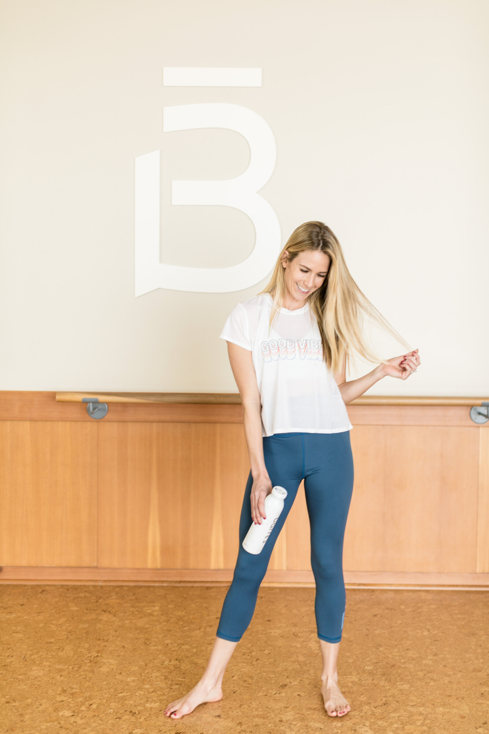 girl standing at barre