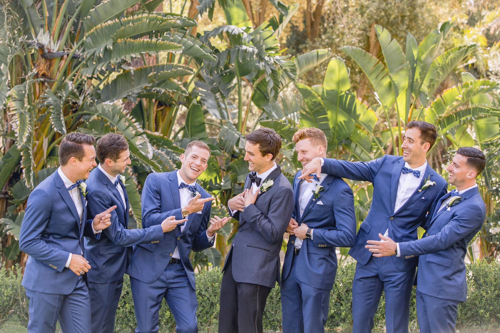newhall mansion groomsmen  goofing off during portraits