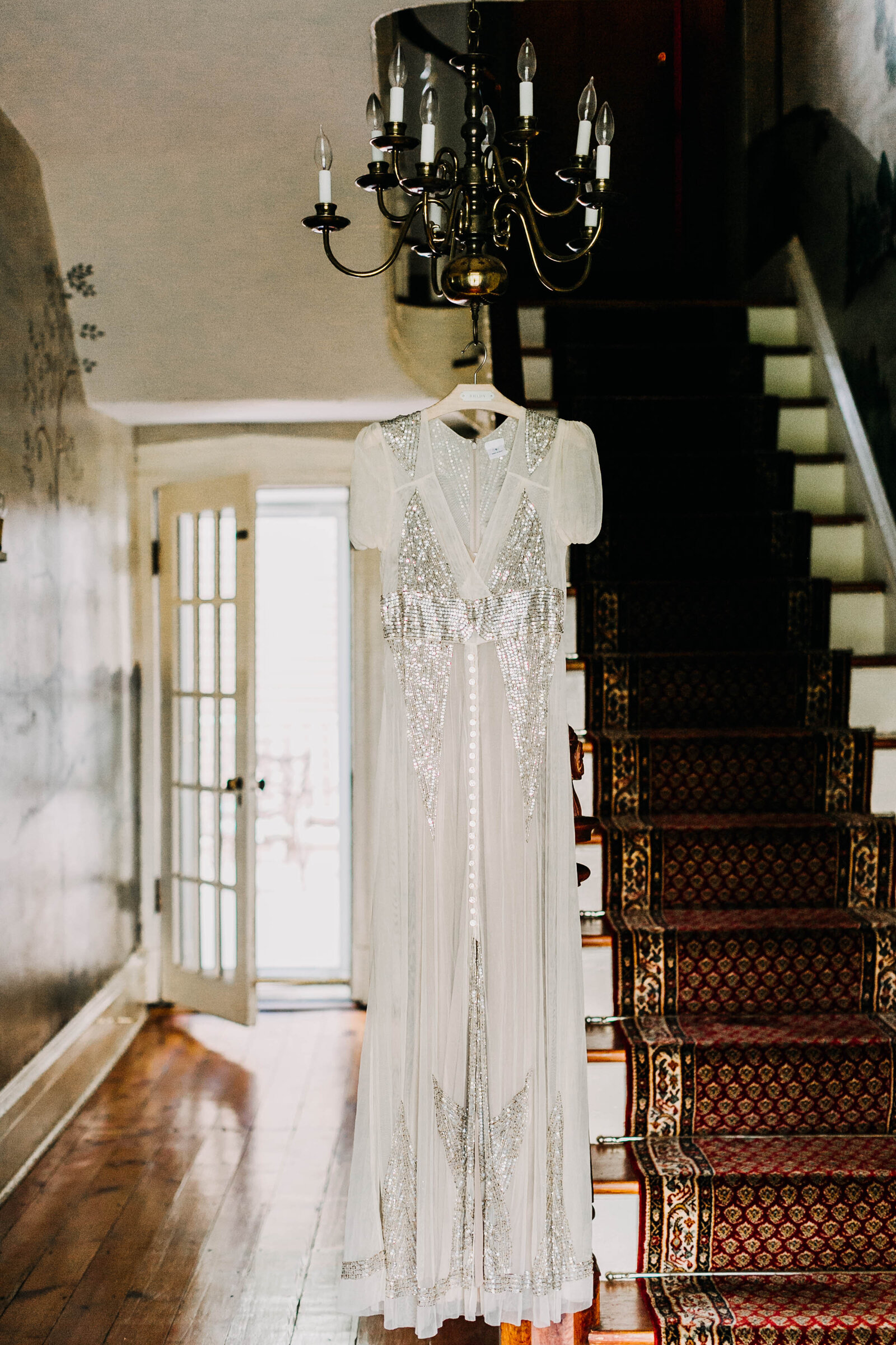 wedding dress hanging in estate venue