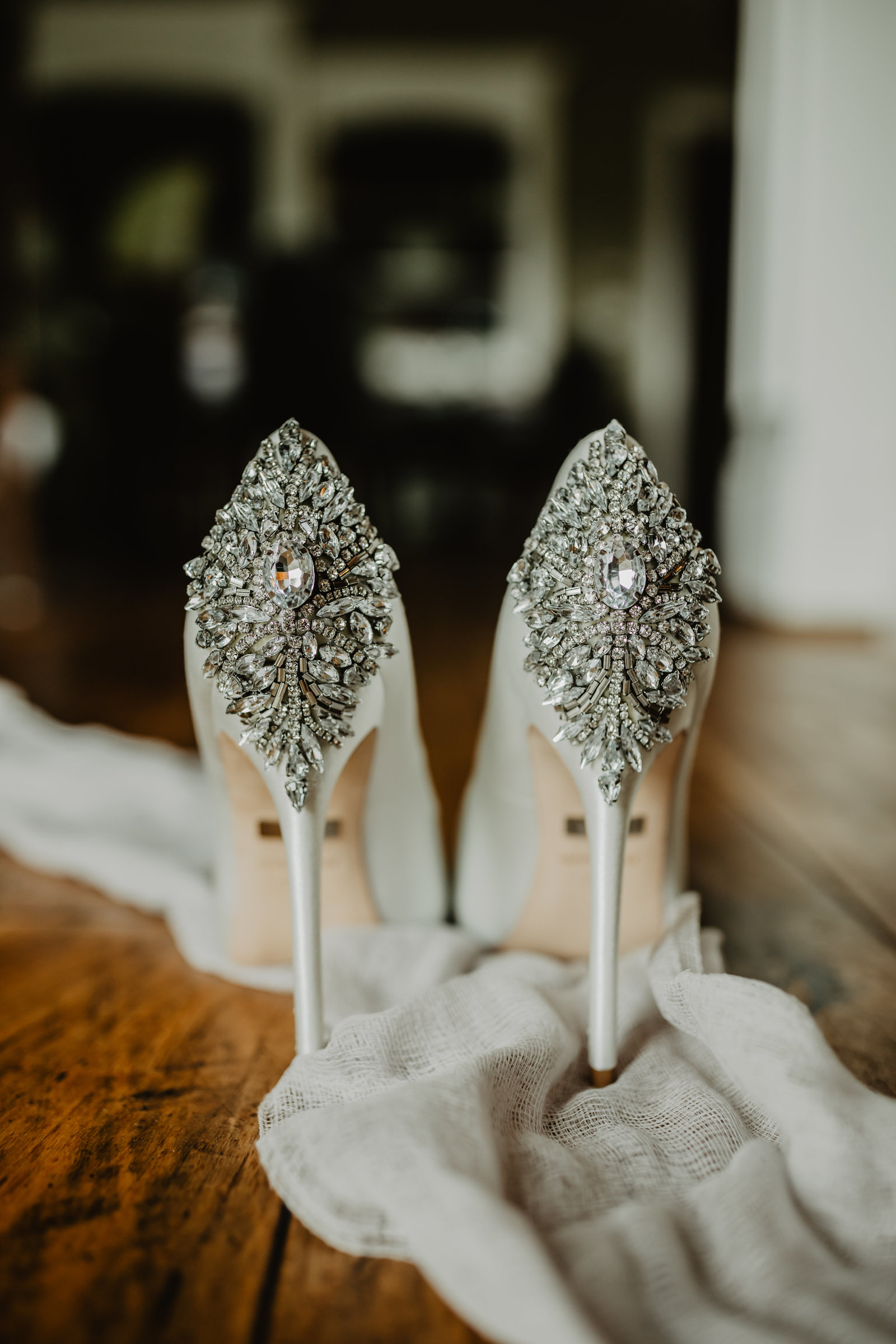 Badgley Mischka white satin wedding heels.