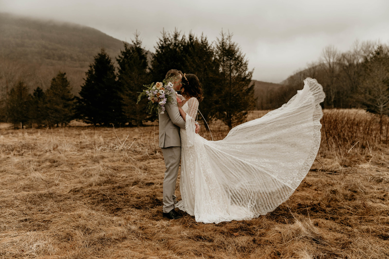 bride and groom portraits with a mountainous setting.