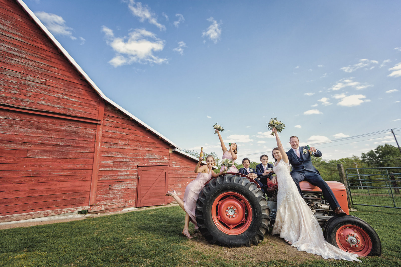 Rustic Grace Estate family wedding photo on a tractor