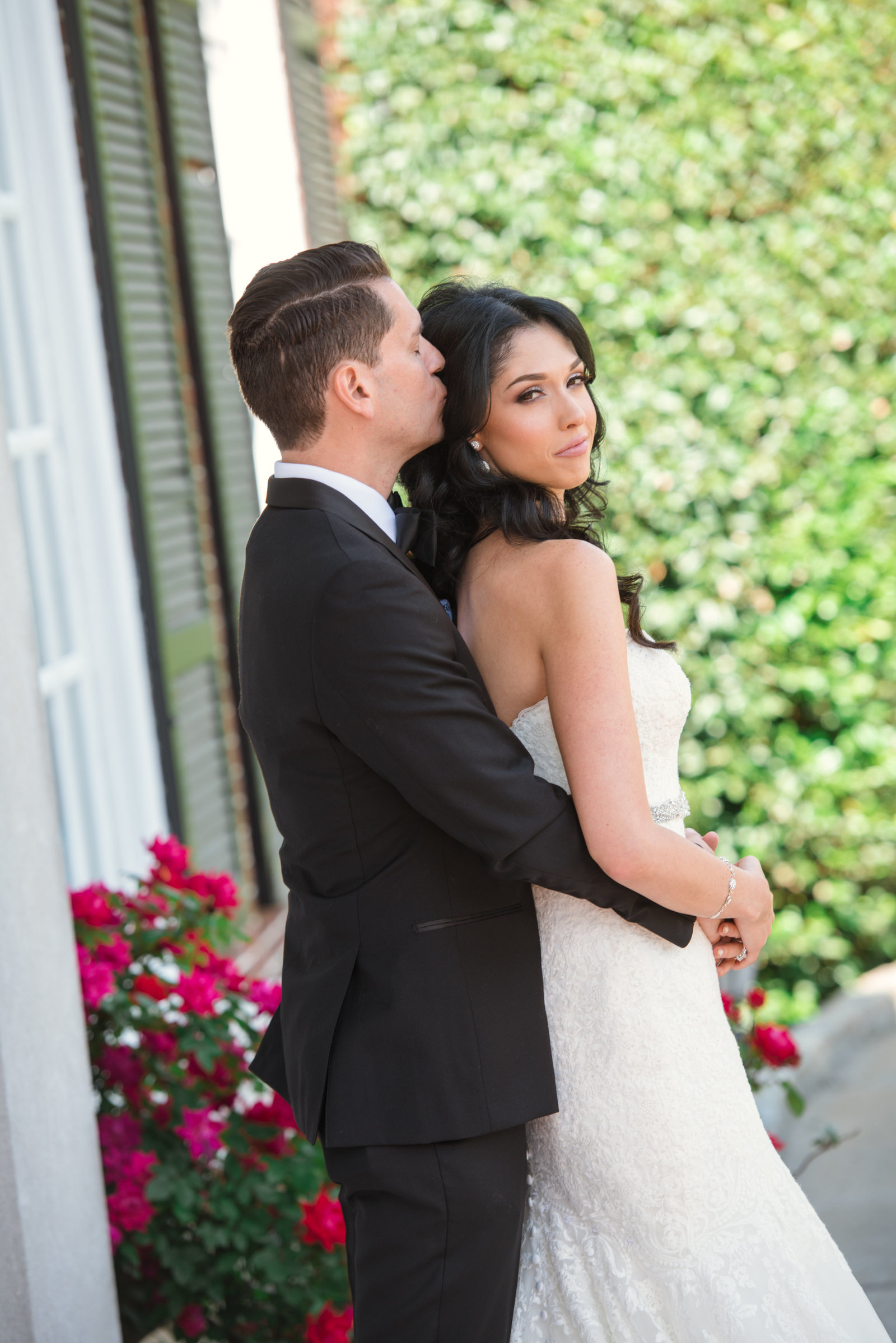Bride and groom hugging at Glen Cove Mansion