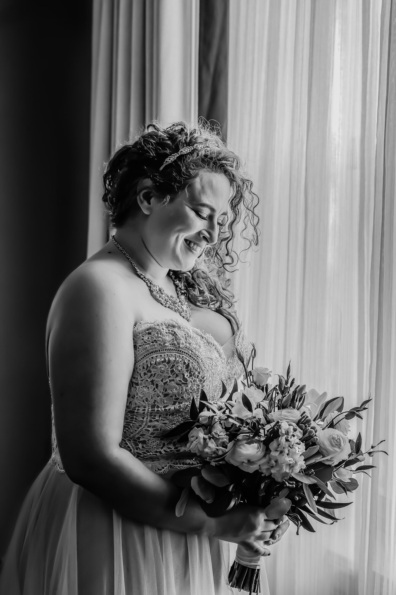 Black and white portrait of a smiling bride before her wedding