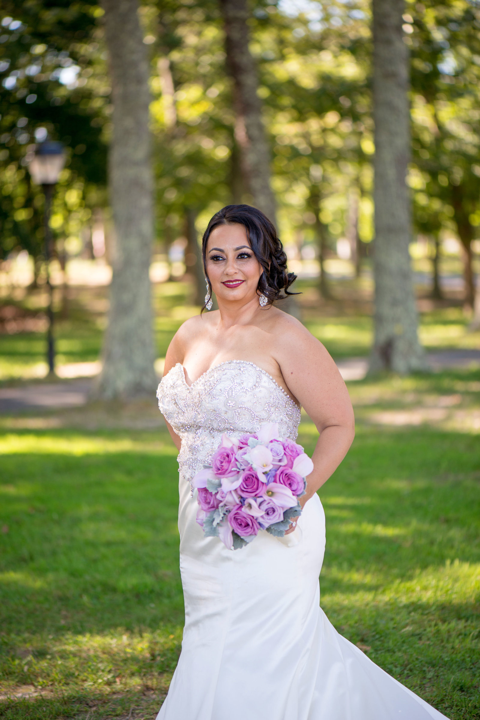 Bride outside with bouquet at Camp Pa-Qua-Tuck