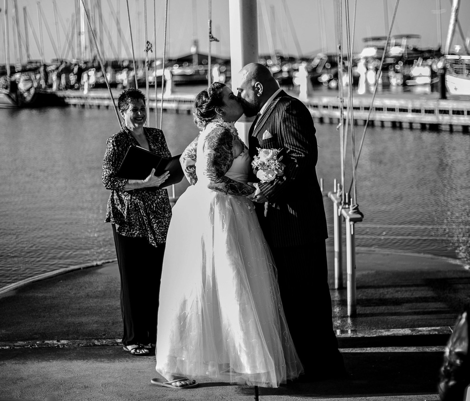 Bride and groom share first kiss at the end of their Erie Yacht Club wedding