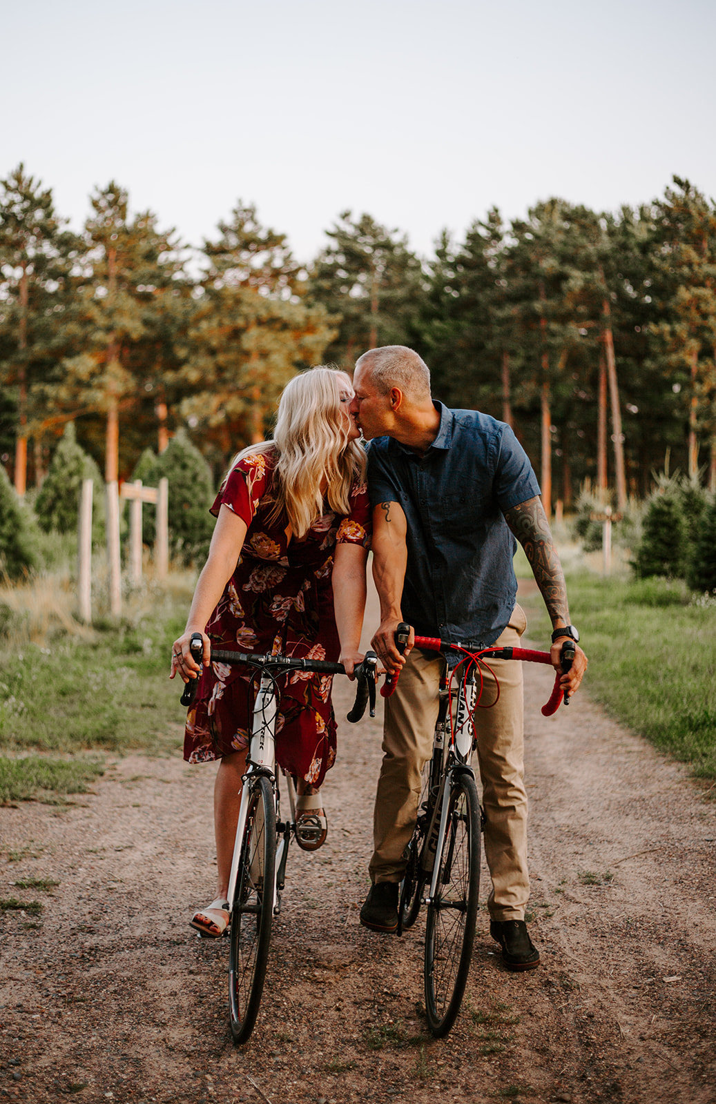 Couple riding bikes and sharing a kiss during their Minneapoolis engagement session