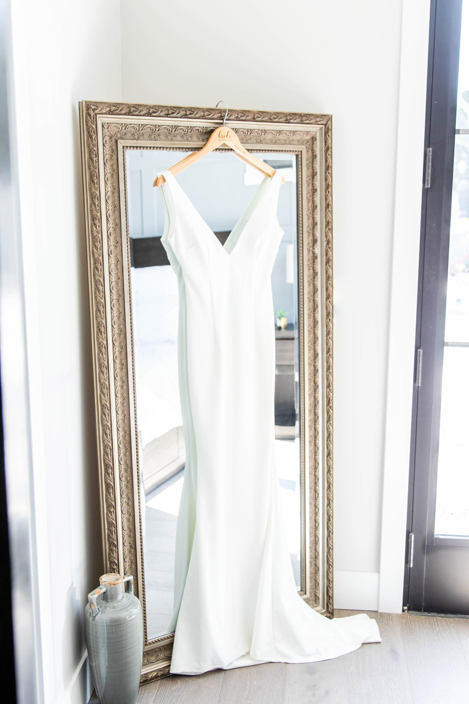 wedding-gown-hanging-from-mirror