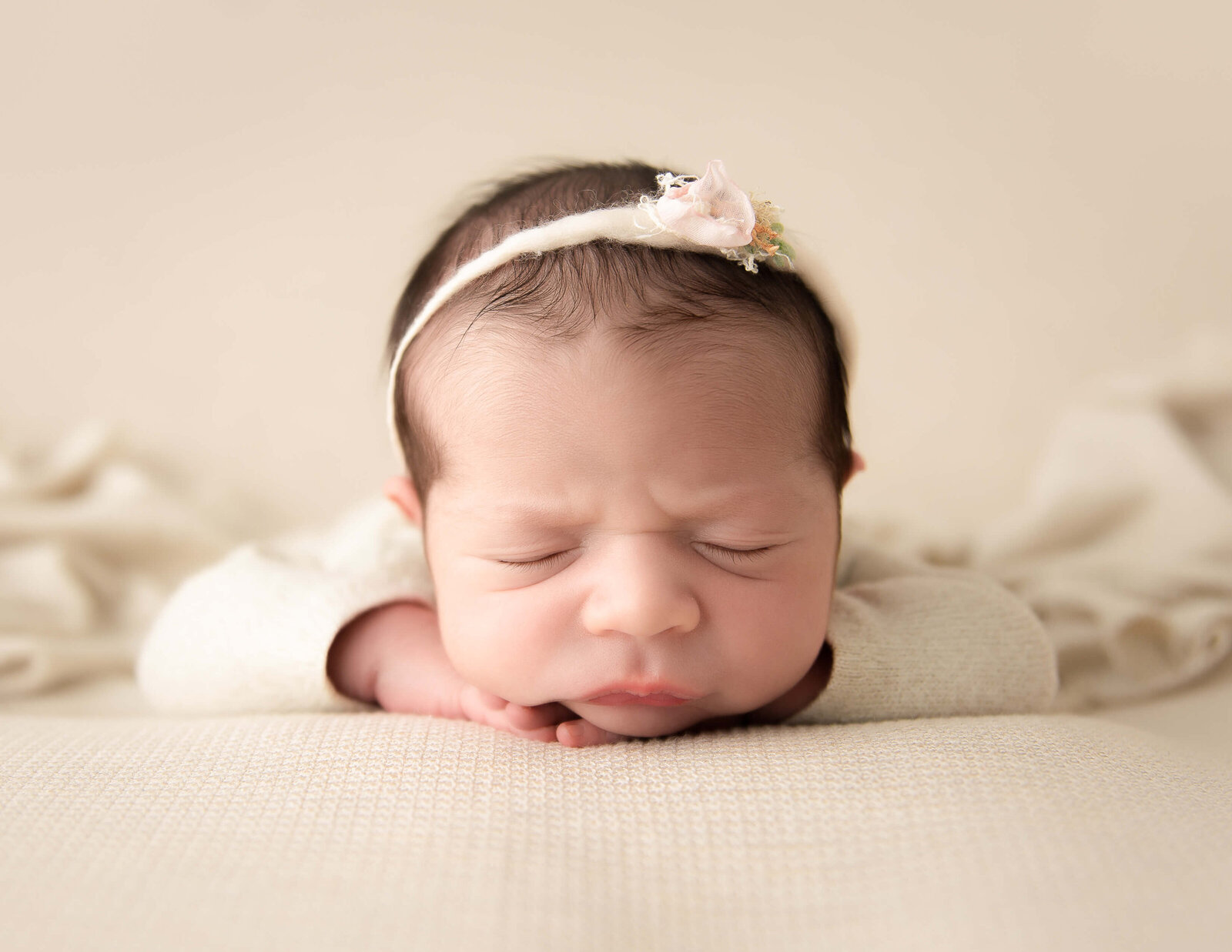 Sweet newborn posed  at our studio in Rochester, NY.