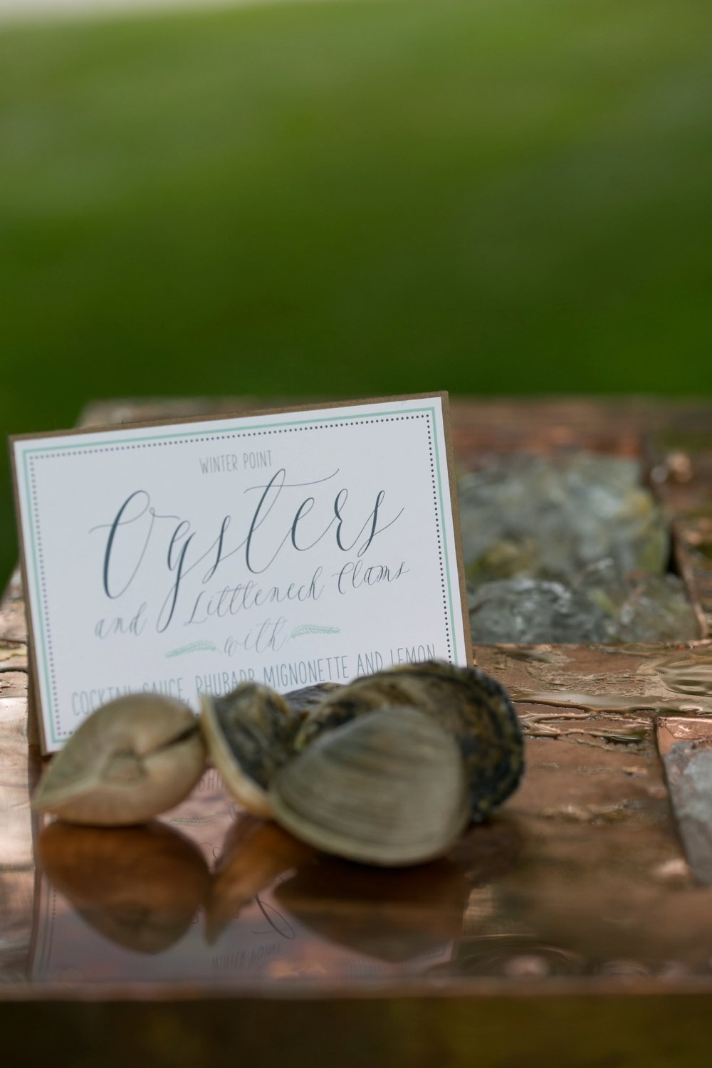 Oyster cocktail hour station via Eventide for rustic wedding at The Barn on Walnut Hill in Maine