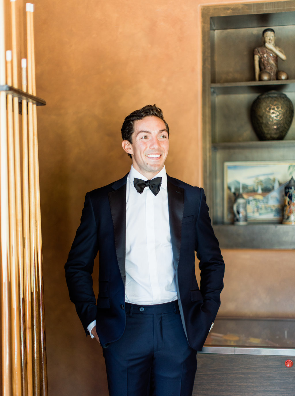 Groom wedding portrait in navy blue tuxedo