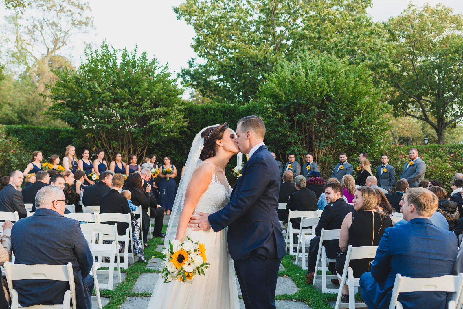 photo of bride and groom kissing after ceremony at Three Village Inn wedding