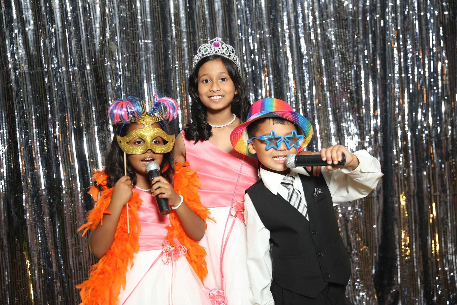 Children wearing props in photobooth. Photo by Ross Photography, Trinidad, W.I..
