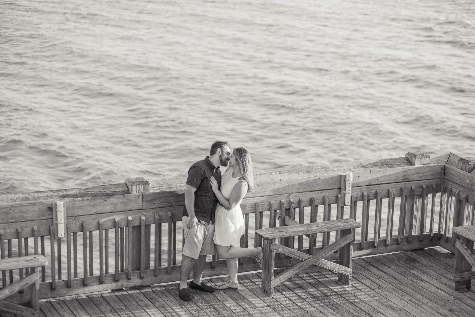 Engaged Couple on fishing pier, Folly beach in Charleston, South Carolina