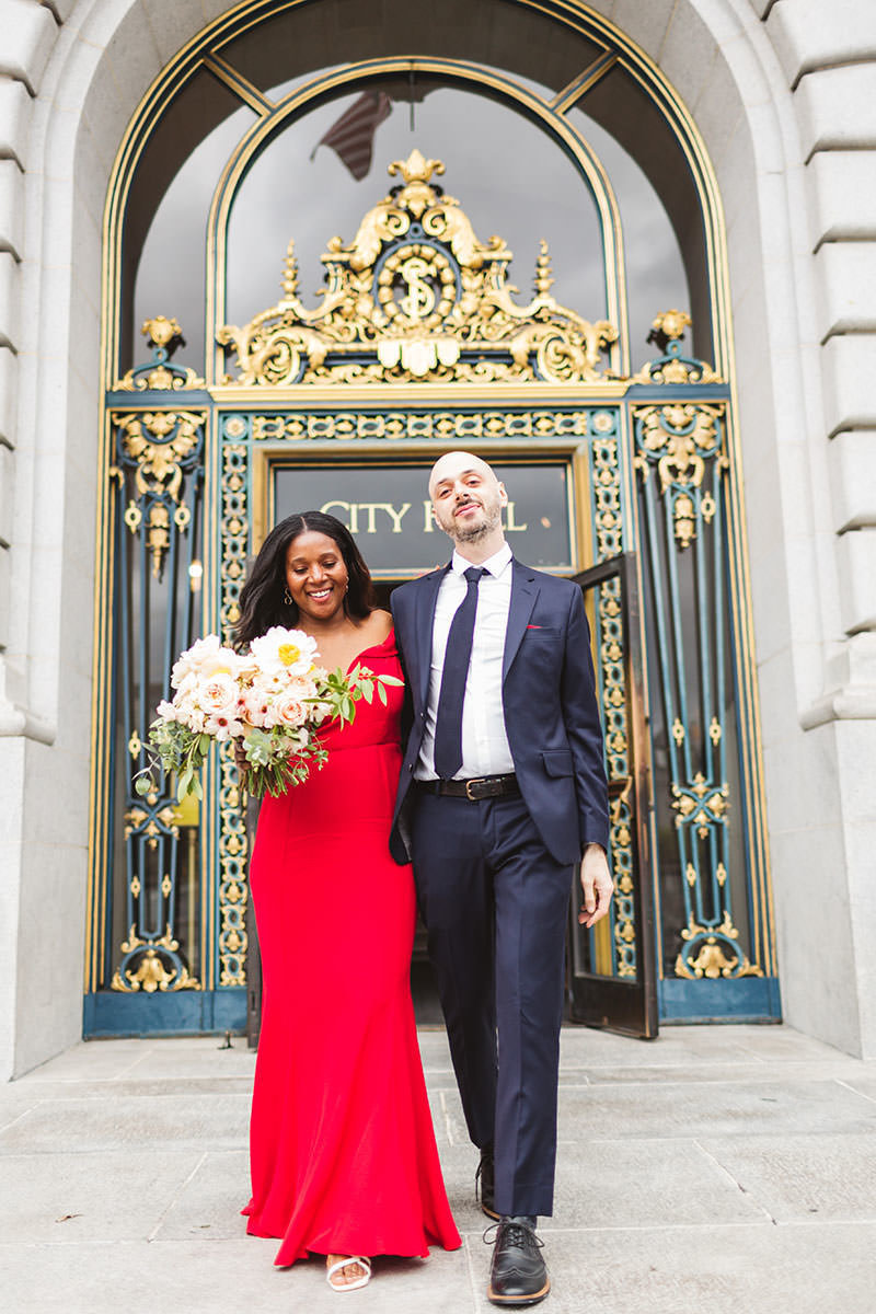 mixed swirl couple leaving San Francisco City Hall on their joyful wedding day by Zoe Larkin Photography