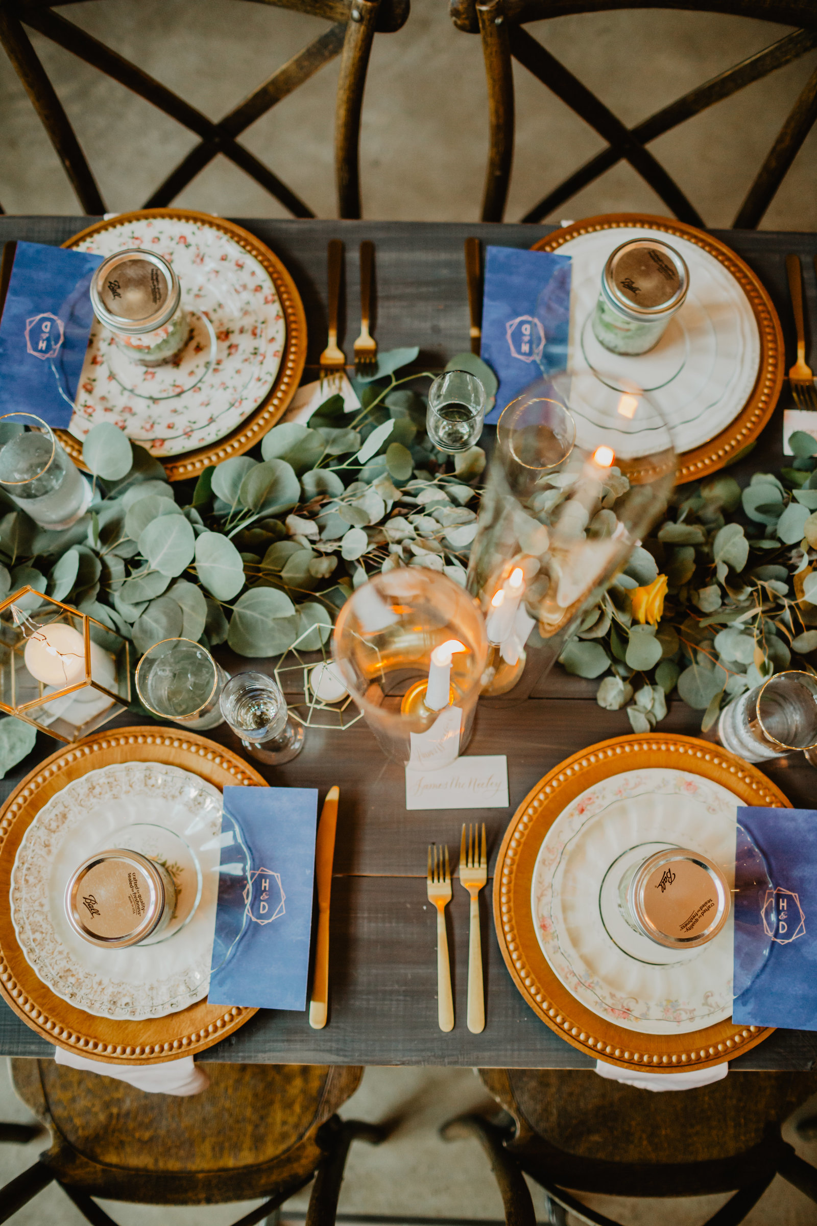 Lush place setting feature eucalyptus florals and gold accents at Allenbrooke Farms