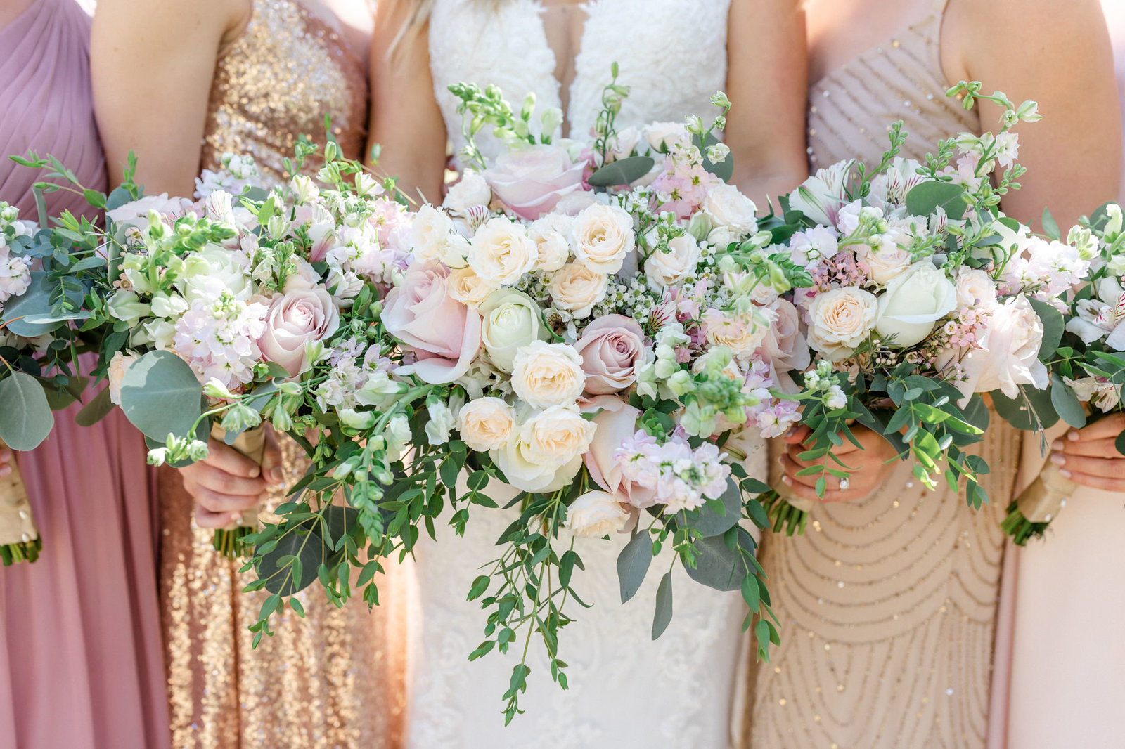 Blush  and white unstructured bouquets