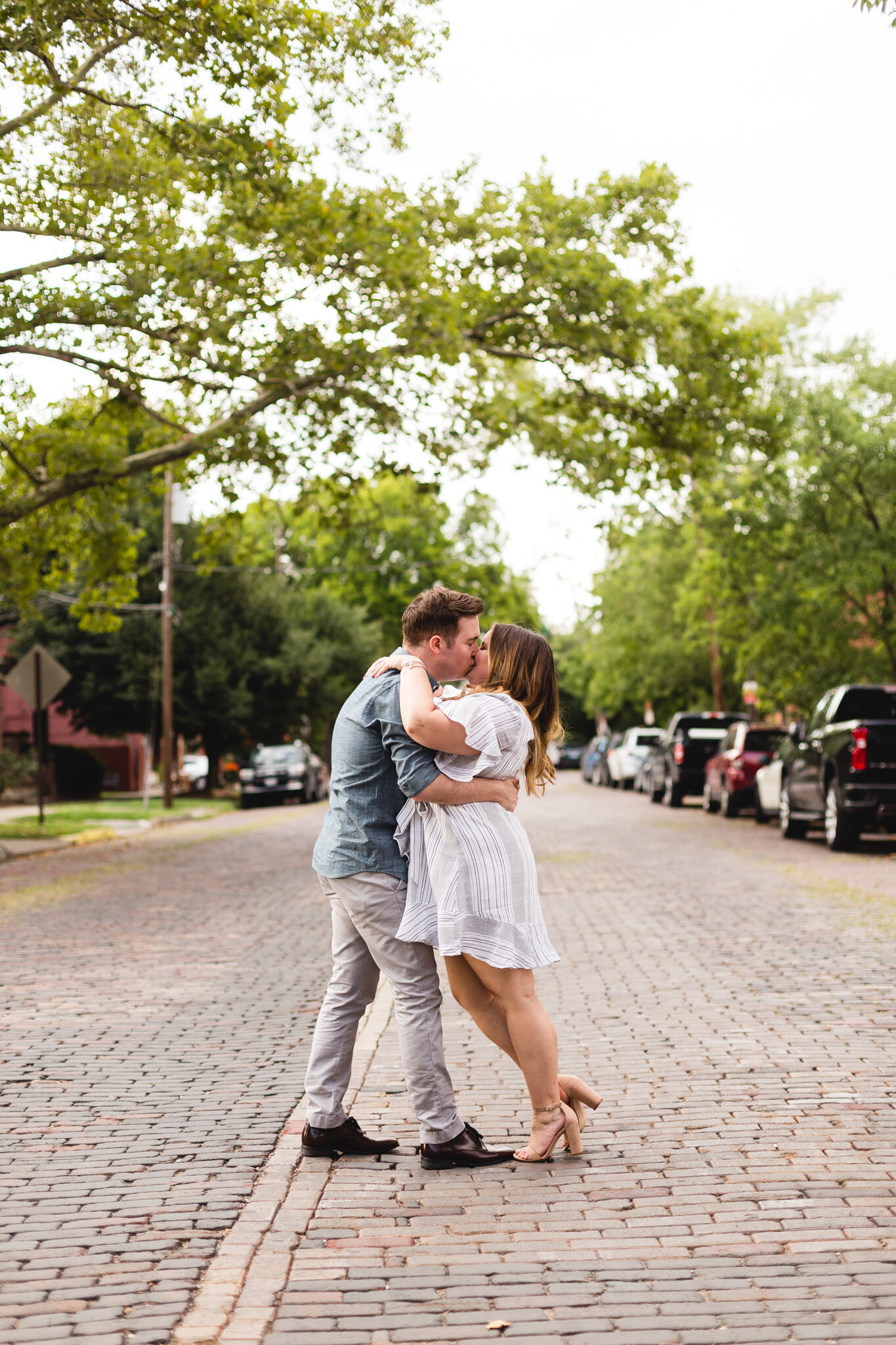 engaged couple kissing in brick road german village ohio photographer