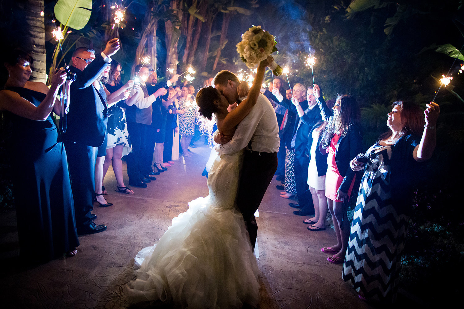 Amazing grand exit photo with sparklers of the bride and groom