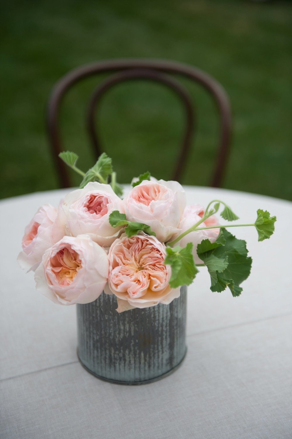 Blush garden roses cocktail table centerpiece at The Barn on Walnut Hll