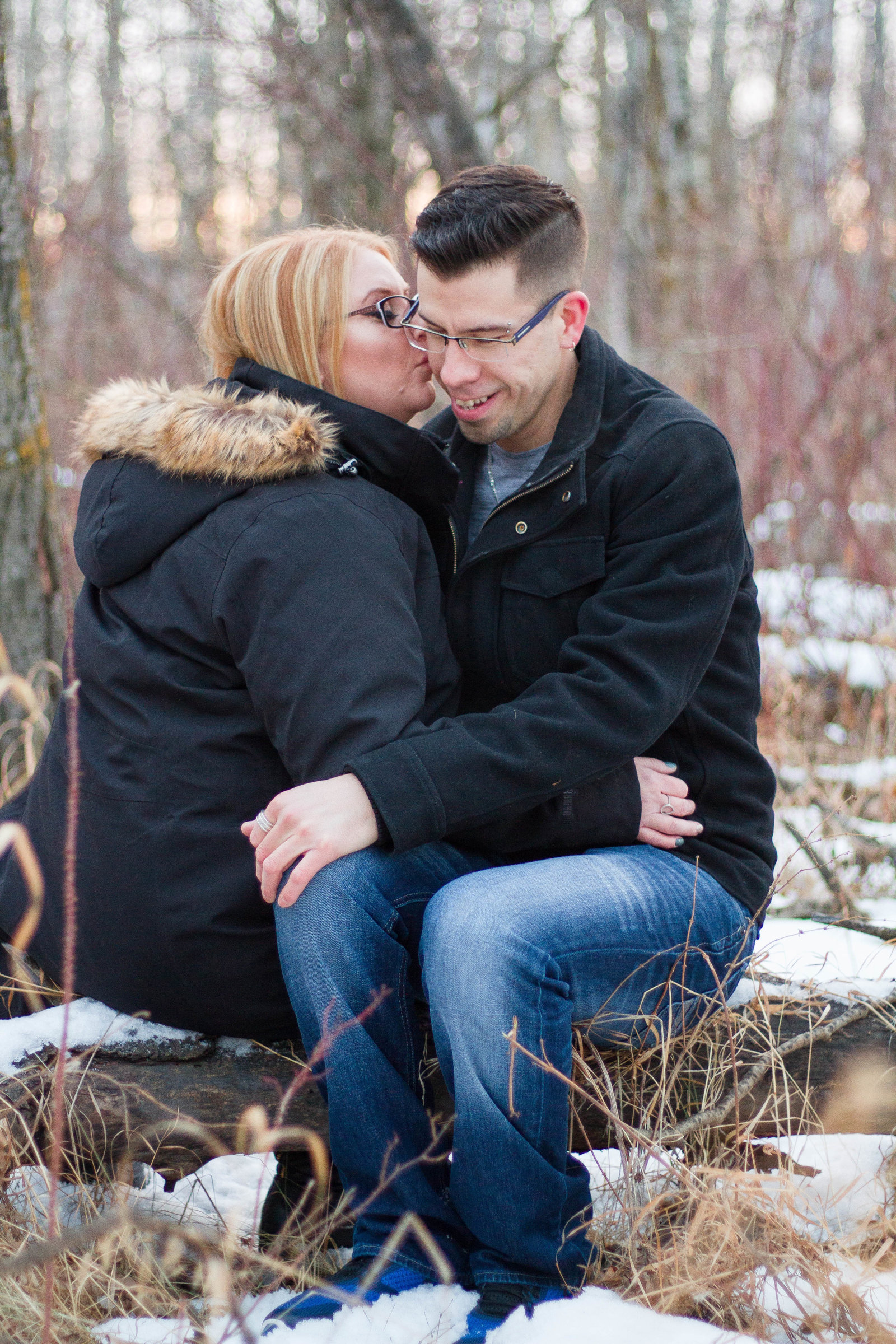Stunning sunset intimate couple session in Alberta winter wonderland featuring birch trees and golden tones.