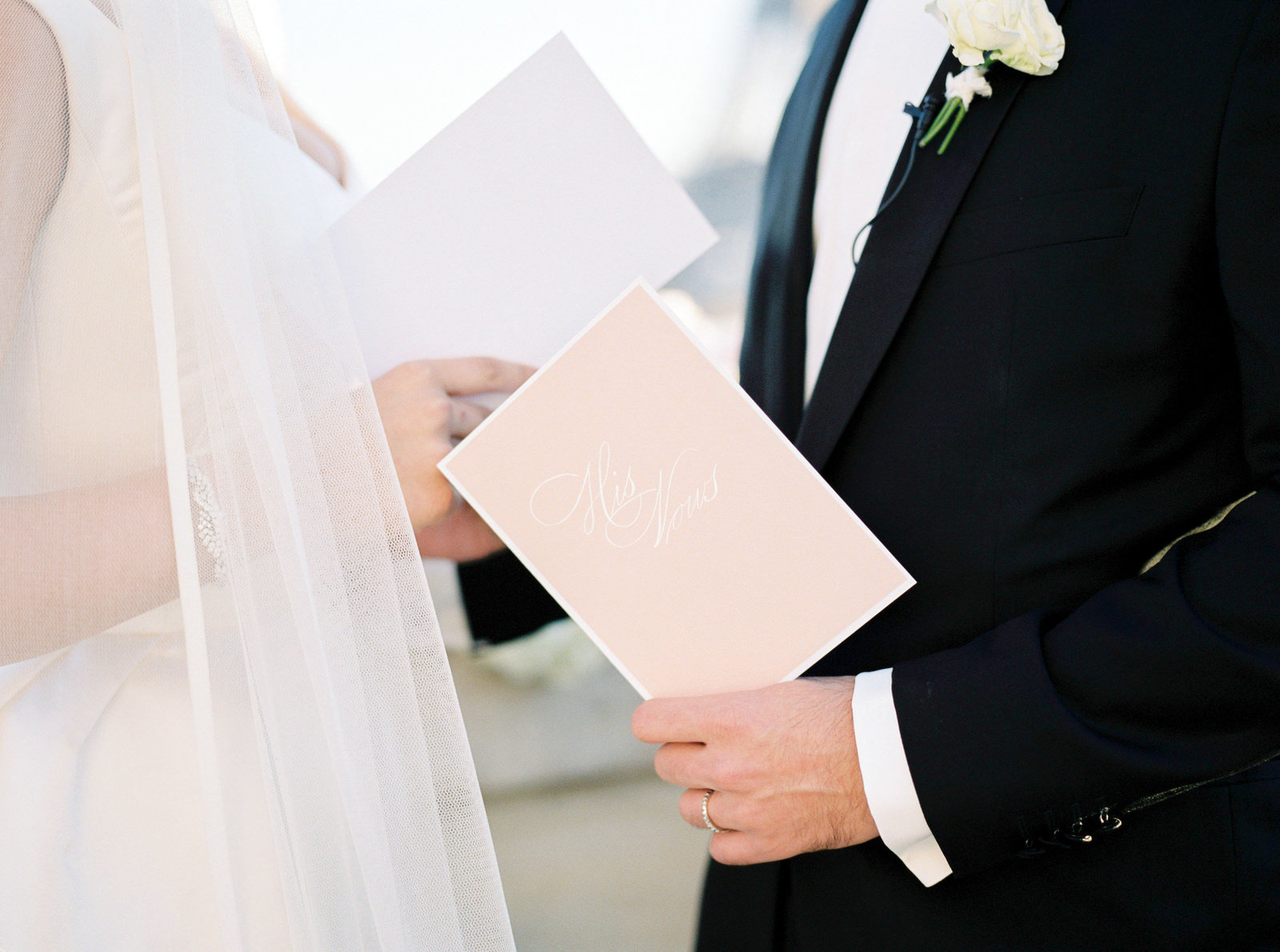 Blush and white wedding vow booklets