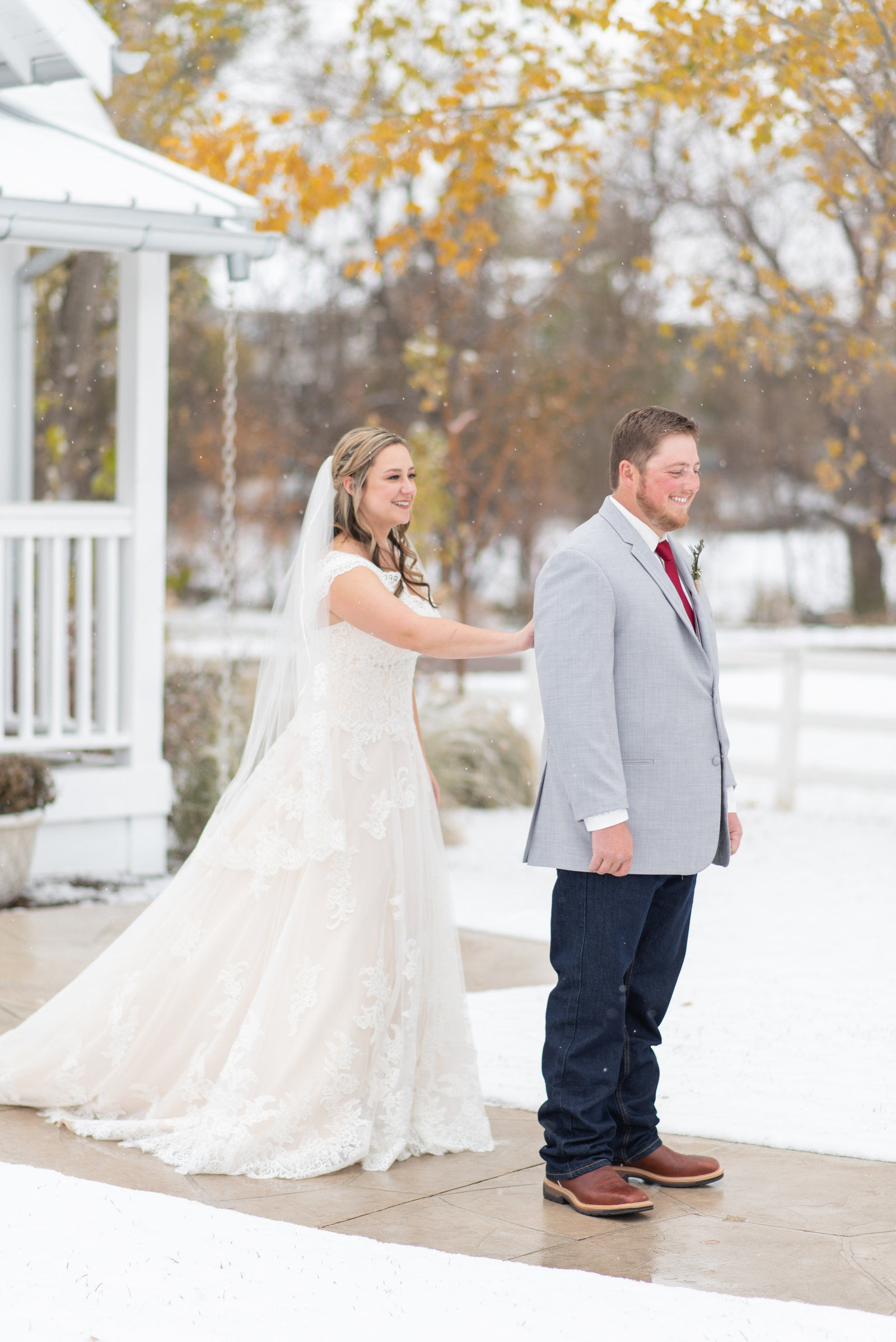 Bride and groom snow first look Raccoon Creek Golf Course
