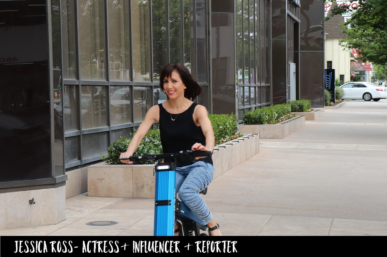 Actress Jessica Theodorou cruising around the streets of LA on a Blue Go-Bike M2