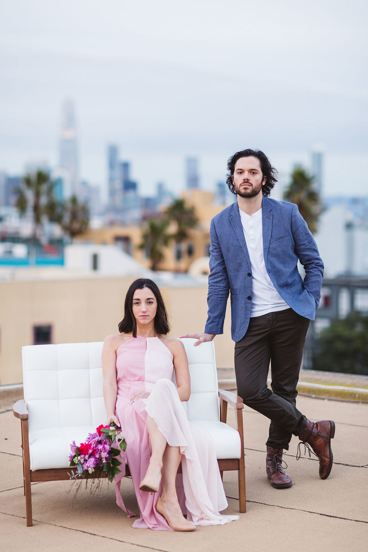 rooftop styled engagement shoot with soft pinks and hot pink bouquet