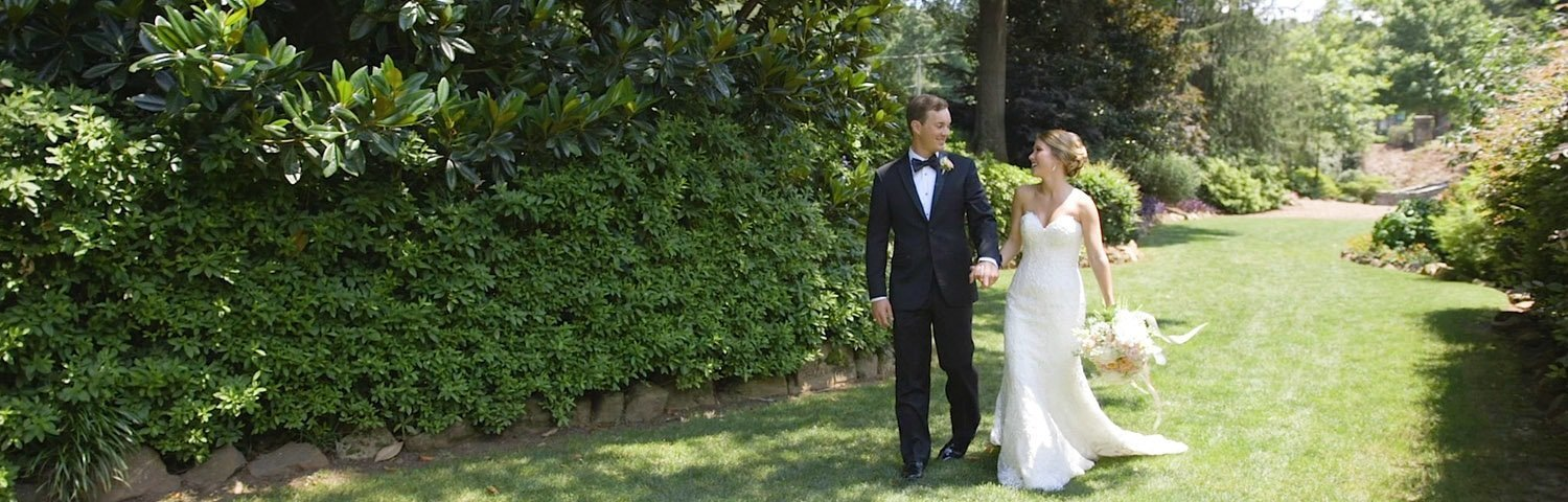 Bride and groom walking  in  a park near downtown Greenville, SC