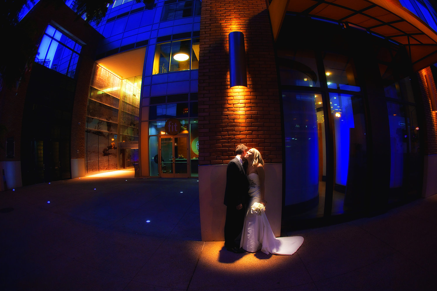 Awesome night time portrait of wedding couple downtown