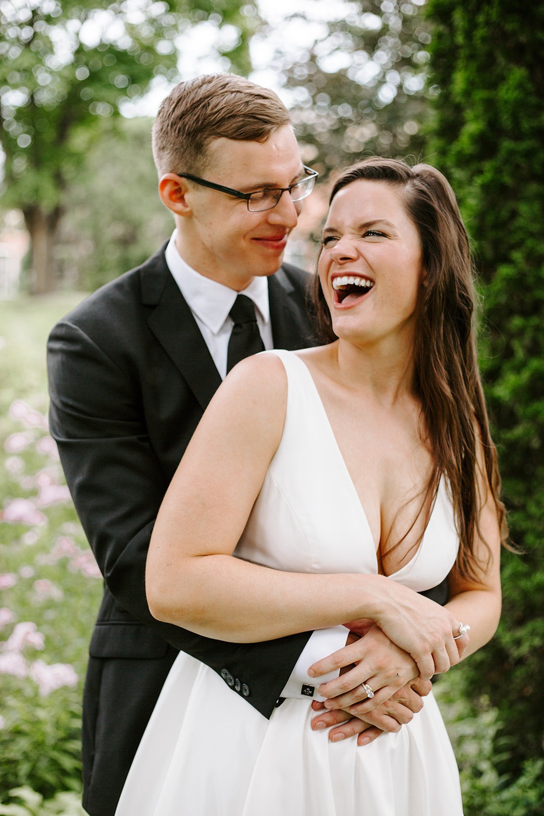 Bride and groom smiling and laughing at each other during their Minneapolis wedding day