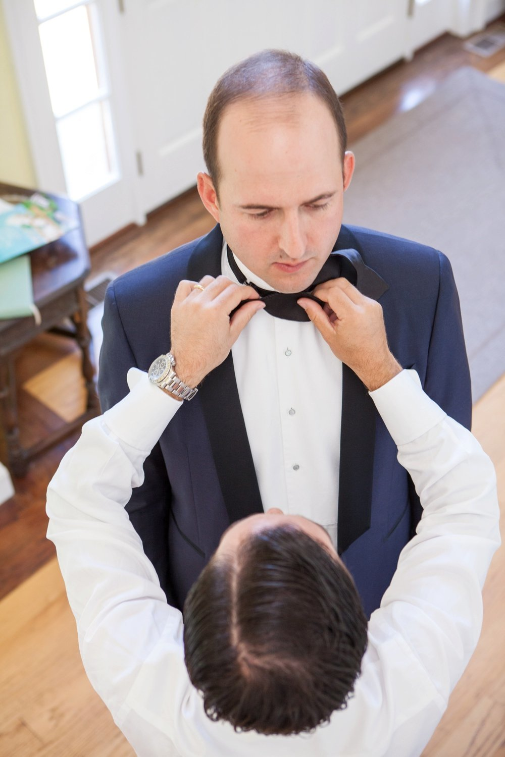 Groom getting ready for wedding at Eisenhower House wedding in Newport, RI