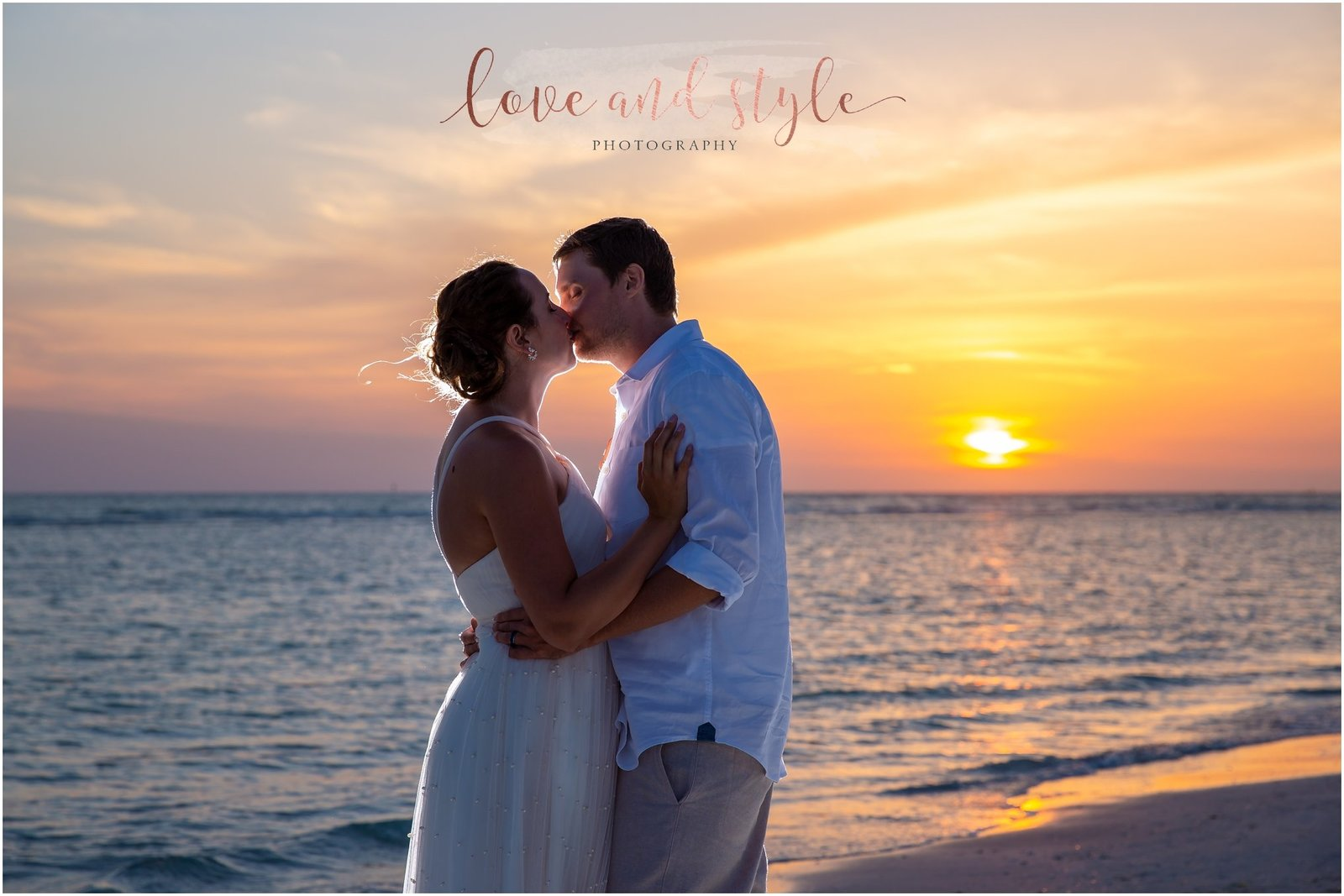Lido Beach Wedding Photography of bride and groom kissing at sunset