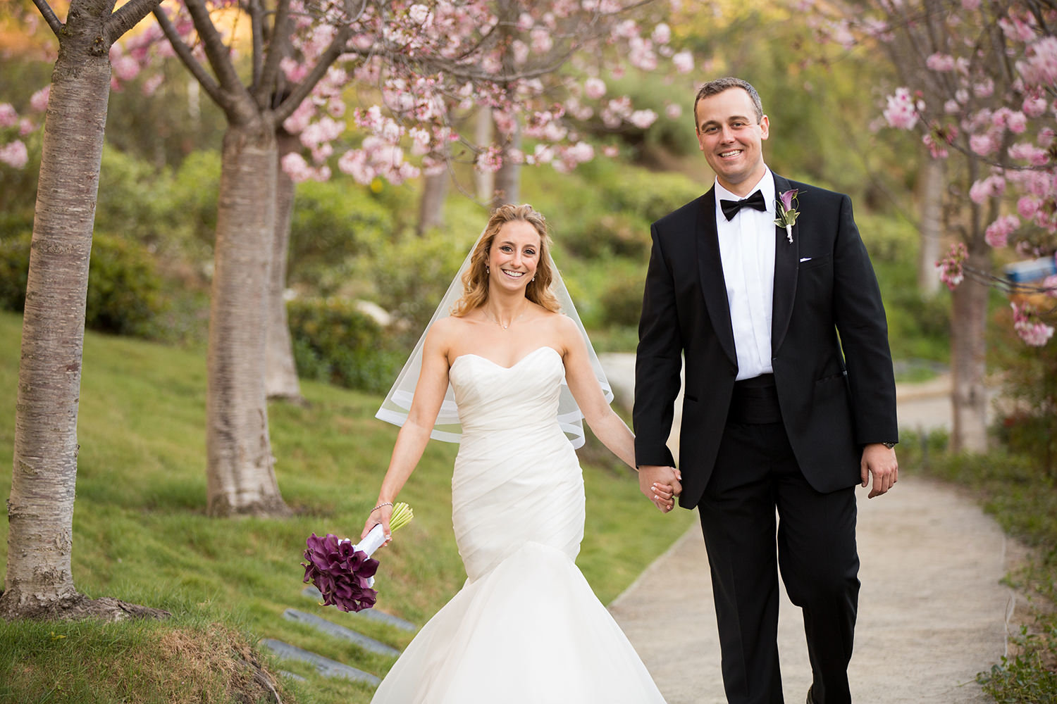 couple walking with cherry blossom trees