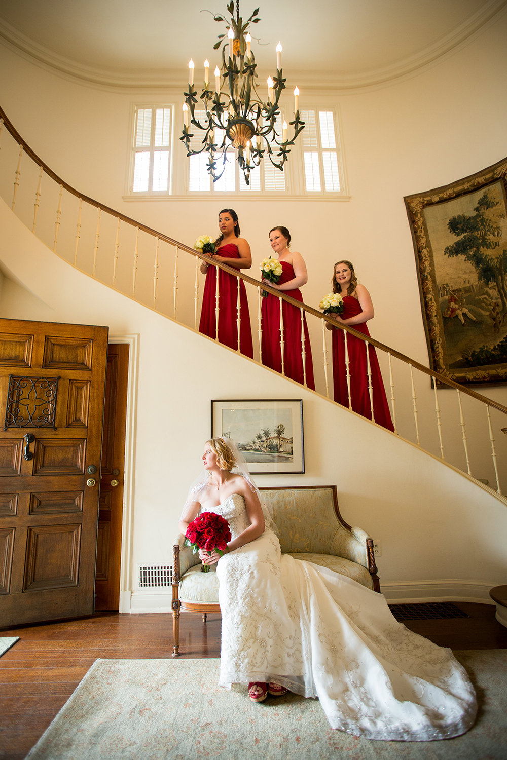 bride with bridesmaids on stairs at darlington house