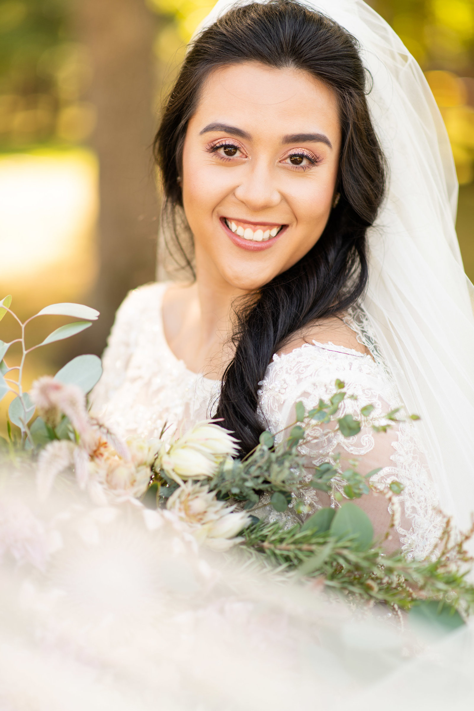 bridal portrait with bouquet and flowing veil