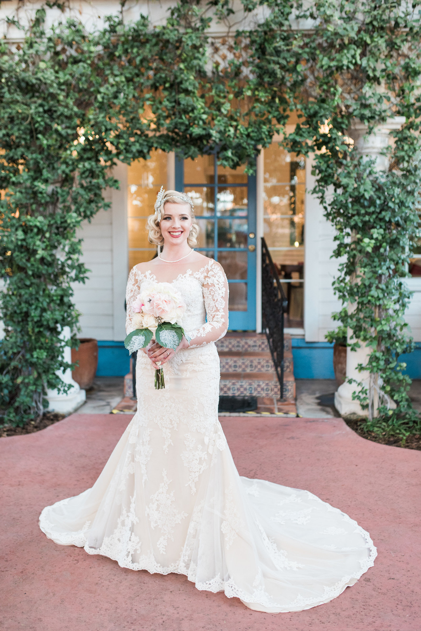Downtown Tucson Z Mansion Wedding Photo of Classic Bride in Lace Gown with Bouquet | Tucson Wedding Photographer | West End Photography