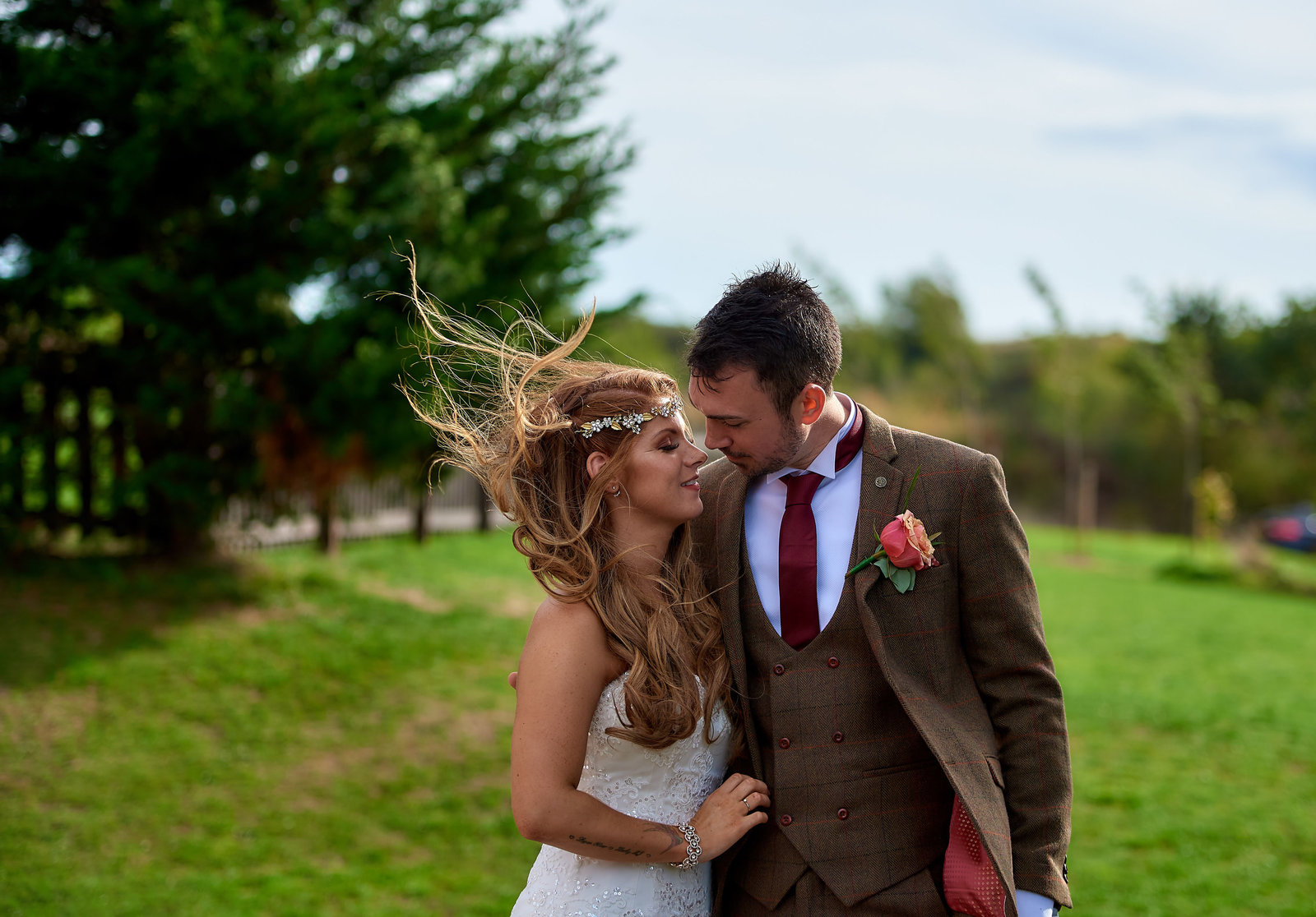 Bride and groom share a tender moment at three lakes wedding venue in ware - Essex wedding photographer