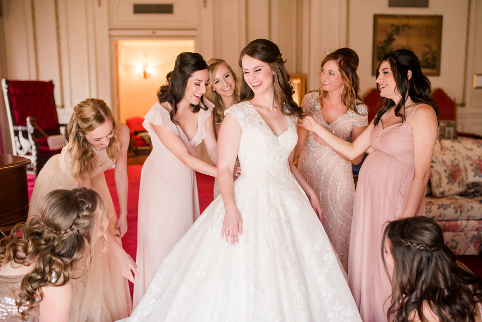 Dallas Wedding Photographer photographs bride getting ready at Scottish Rite Cathedral