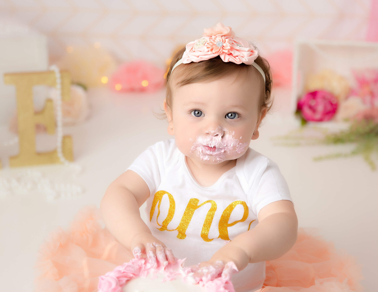 Beautiful one year old girl at her cake smash in our studio in Rochester, NY